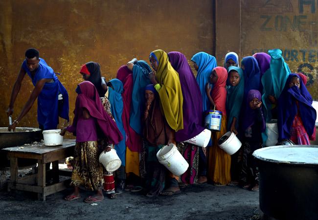 Young girls line up at a feeding centre in Mogadishu, Somalia in March 2017. (Credit: UN Photo/Tobin Jones)