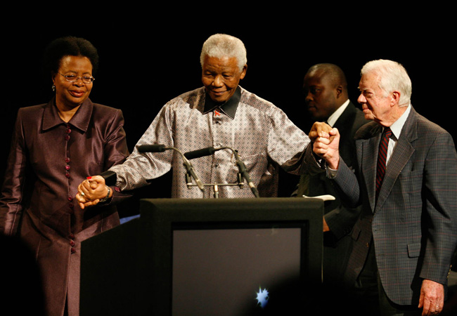 Graça Machel, Nelson Mandela and Jimmy Carter at the launch of The Elders in Johannesburg in July 2007 (Credit: Benny Gool / The Elders)