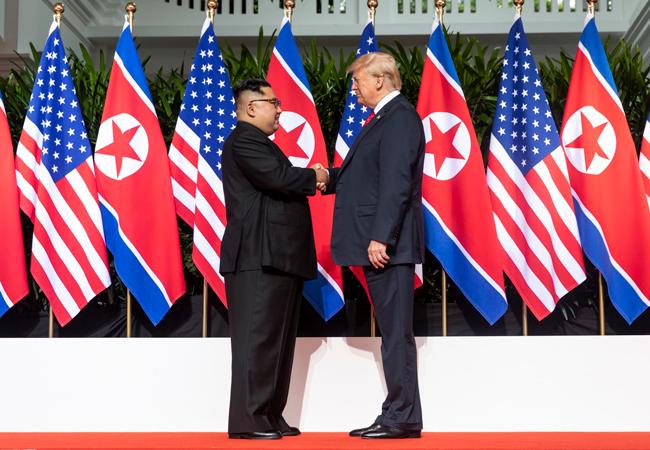 Kim Jon-un and Trump shake hands at Singapore Summit
