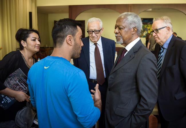 Kofi Annan, Lakhdar Brahimi and Martti Ahtisaari hear from refugees at the Marienfelde refugee centre. (Credit: Gordon Welters/The Elders)